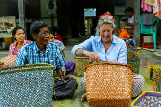 Michal with Head Weaver in Myanmar creating Mowgs petal basket