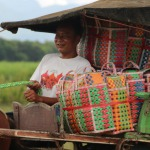 Myanmar villager on a cart with Mowgs basket for transport