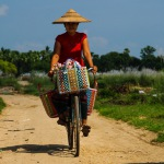 Myanmar villager on bicycle with handwoven bike basket