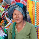 Burmese lady with handwoven colourful baskets