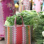 Handwoven baskets with local produce at market