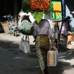 Local villager carrying flowers and handwoven basket