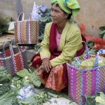 Local villager at local market selling produce with baskets