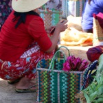 Myanmar villager with handwoven basket and flowers