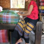 Artisan weaving a colourful Myanmar inspired basket
